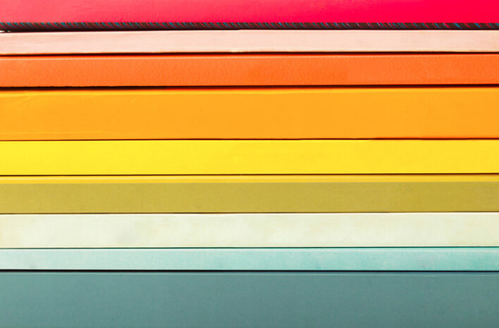 Canon   Publicering   Pakkede bøger i farver