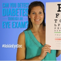 eye doctor holding eye chart