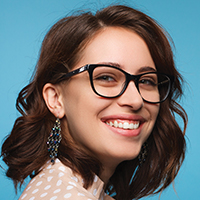 woman wearing eyeglasses smiling